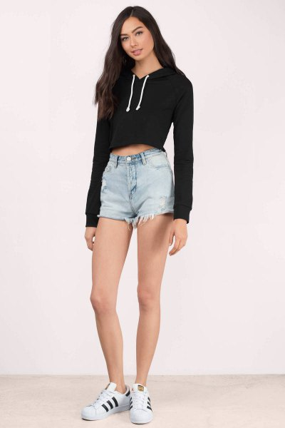 black, cropped hoodie jeans shorts, white sneakers