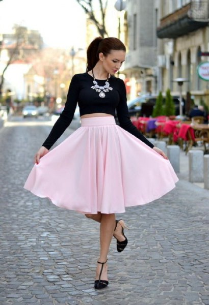 black short-cut long-sleeved T-shirt with light pink midi skirt