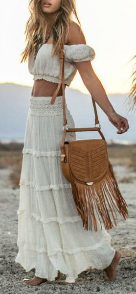Black cut from the top of the shoulder with a high-waisted maxi gypsy skirt