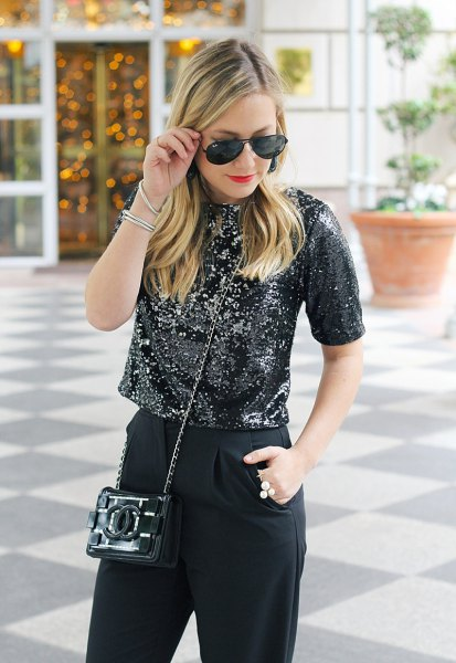 black, cropped sequin top with slim fit jeans