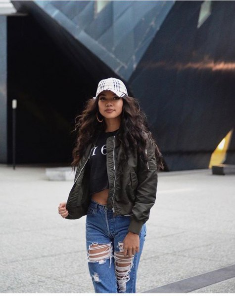 black short t-shirt with olive-green bomber jacket and torn boyfriend jeans