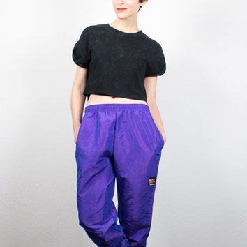 black short t-shirt with royal blue windbreaker pants