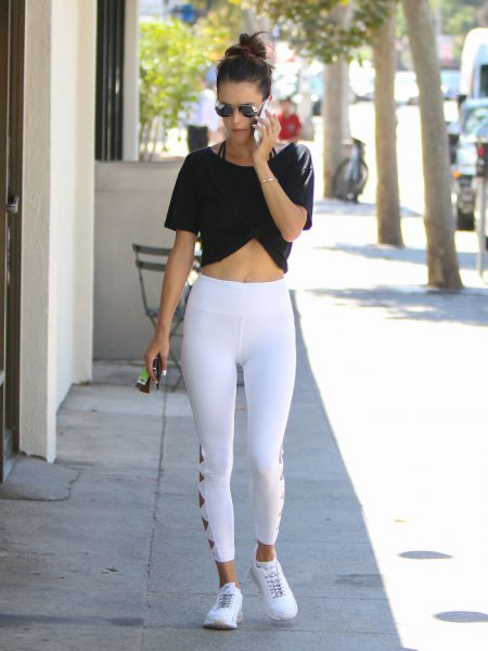 black short t-shirt with white leggings and high-waisted sneakers