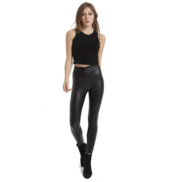 black short tank top with high-waisted leather gaiters