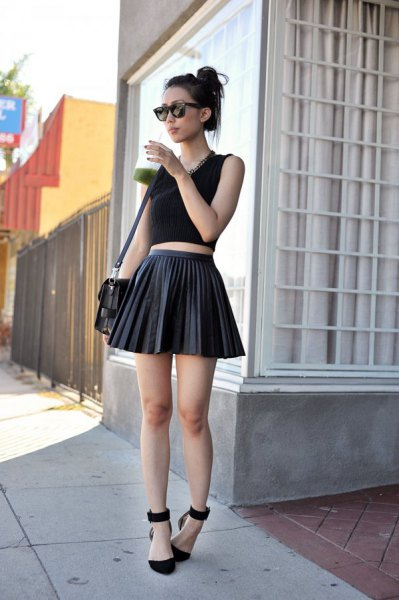 black short tank top with pleated mini-rater leather skirt