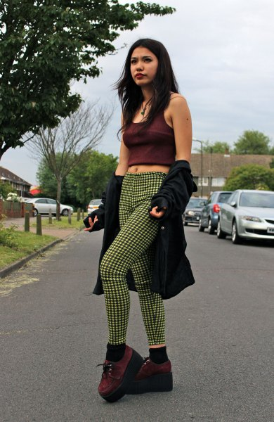 black short tank top with shocking green checked drainpipe pants