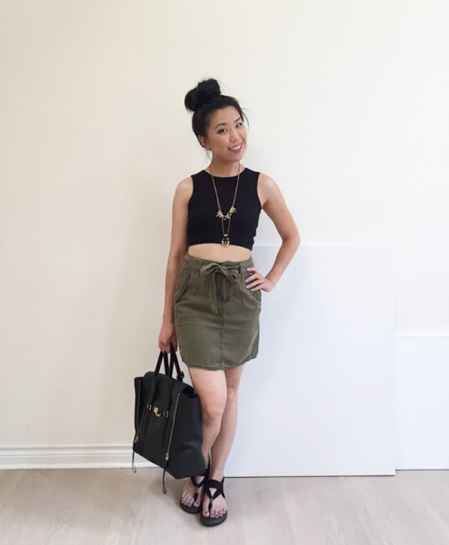 black short tank top with a mini skirt with a tie