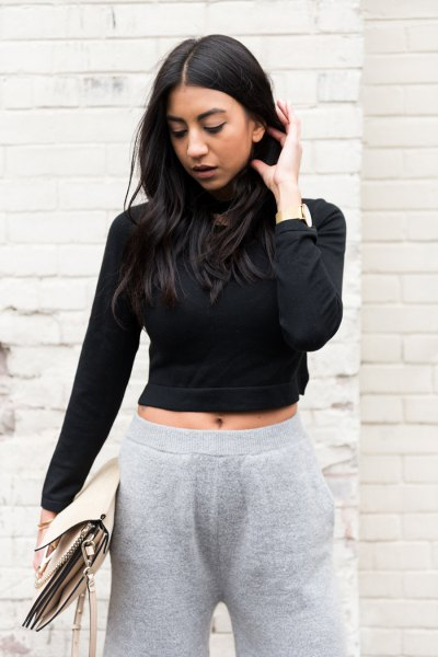 black, short cut turtleneck with gray knitted pants with wide legs