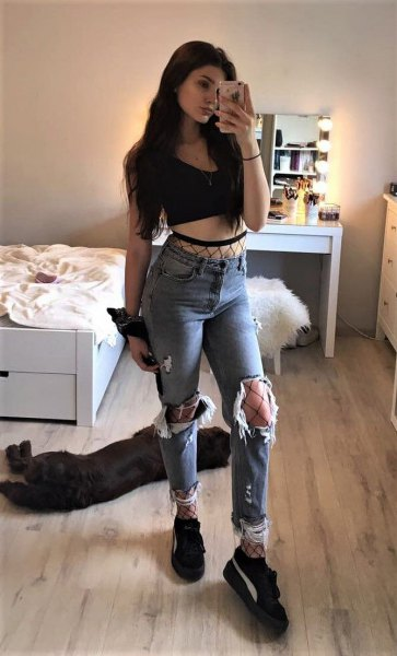 black short vest top with torn boyfriend jeans and platform sneakers