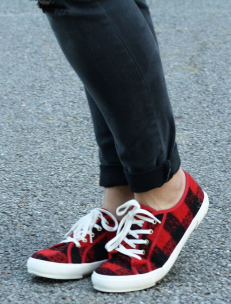 black jeans with cuff and red plaid plimsolls