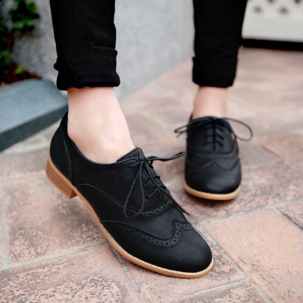 black skinny jeans with cuffs and matching suede oxford shoes