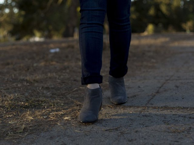 black straight leg jeans and straight short boots with gray side zip