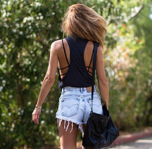 black tank top with neckline at the back and light blue denim shorts