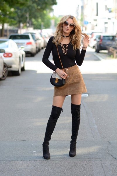black long-sleeved T-shirt with camel mini skirt made of suede
