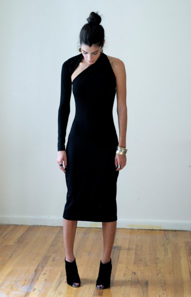black neckline of a strapless midi dress with boots
