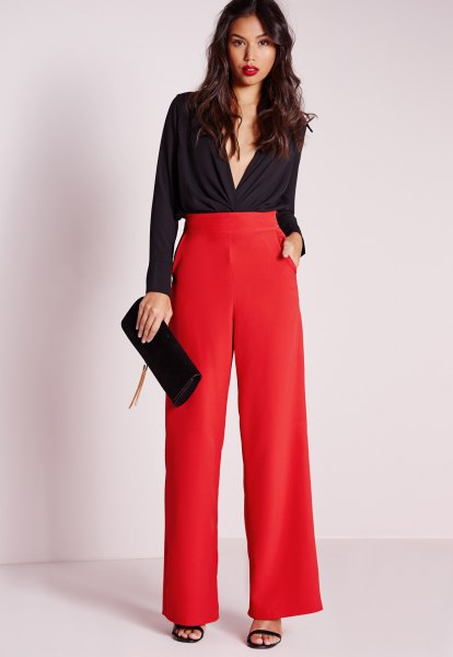 black blouse with deep V-neck and red pants with high waist and wide legs