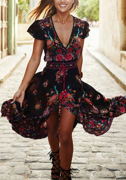black midi dress with floral ruffles and deep V-neck