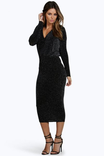 black, long-sleeved, figure-hugging midi dress with deep V-neckline and open toes