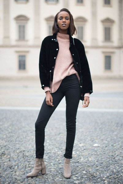 black denim jacket with an ivory-colored, chunky sweater and skinny jeans