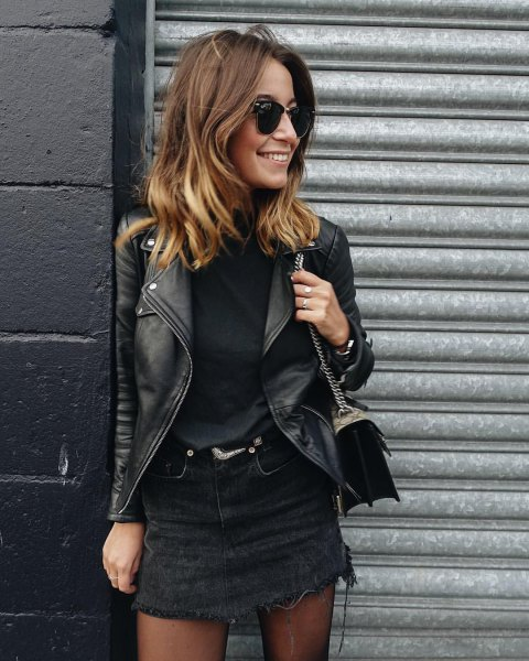 black denim skirt with sweater and leather jacket