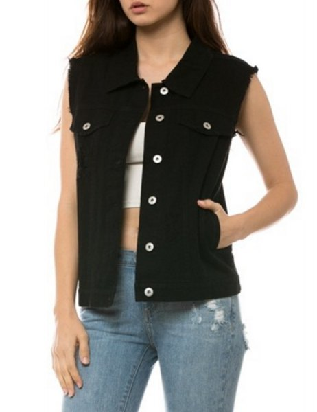 unwashed black denim vest with white crop top and blue ripped jeans