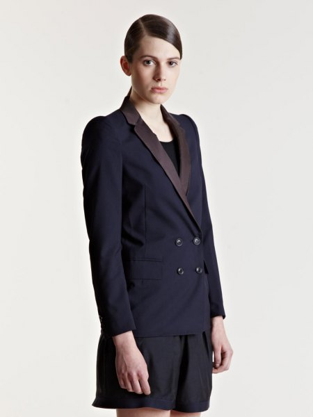 black double-breasted suit jacket with matching flowing shorts