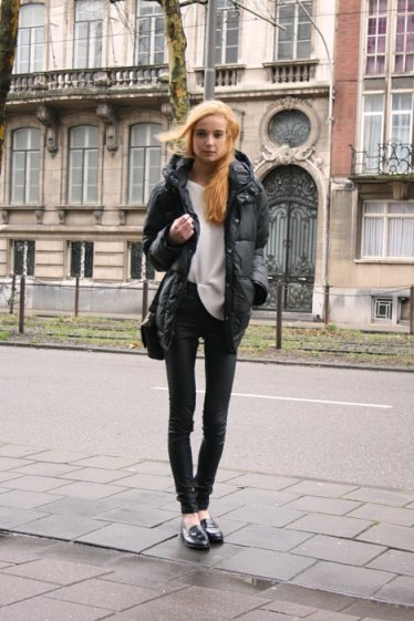 black down jacket with white sweater and leather pants
