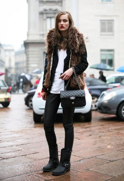 black faux fur coat with leather pants and matt motor boots