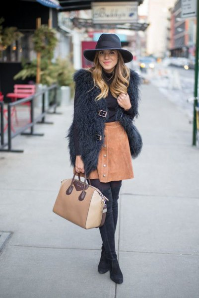 black faux fur coat with light brown suede mini skirt