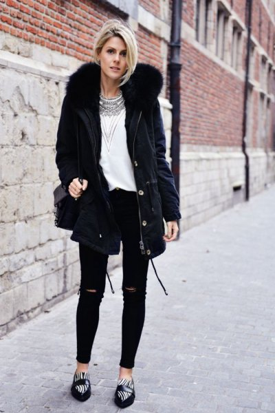 black parka jacket with faux fur collar, white top with tribal print