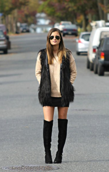 black faux fur vest knee-high boots