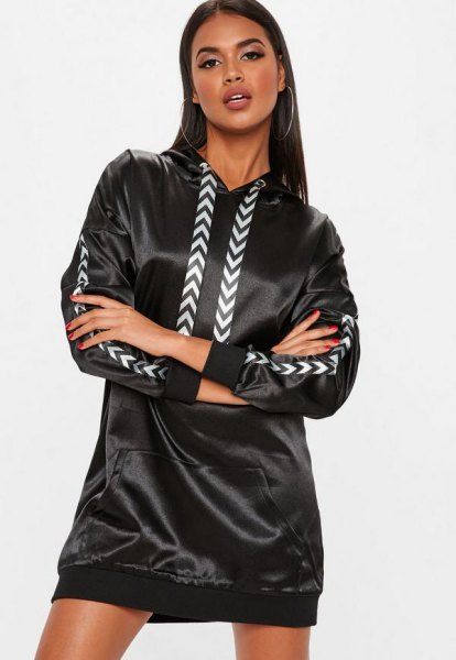 black hooded jacket made of synthetic leather