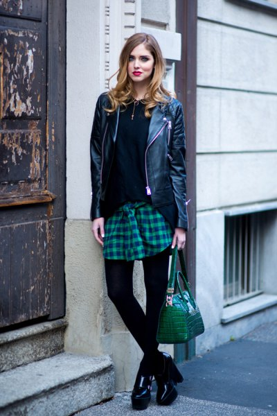black faux leather jacket with dark blue and gray plaid skirt