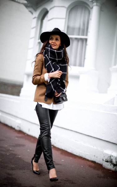 black felt hat and brown blazer and leather gaiters