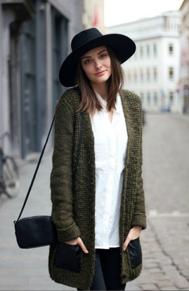 black felt hat with a long gray knitted sweater cardigan