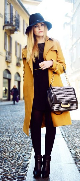 black felt hat with mustard trench longline coat and shift dress