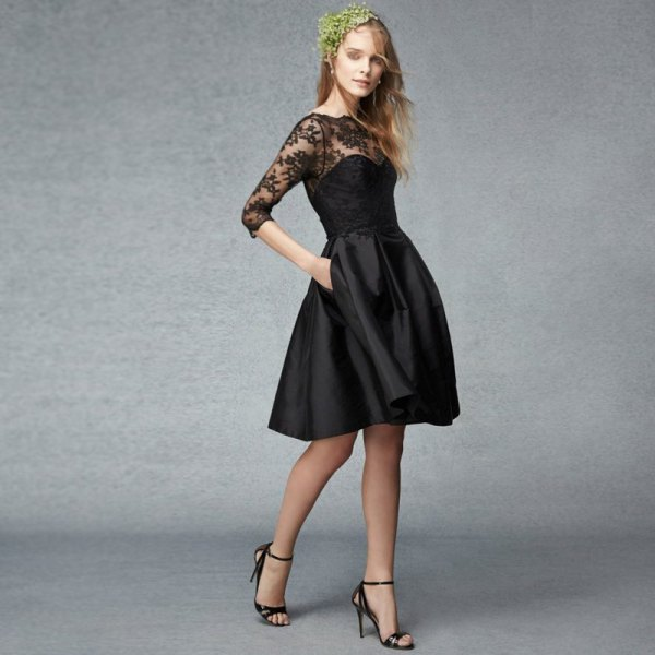 black fit and flared dress with lace details