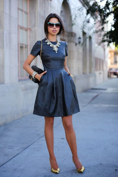 Leather mini dress with black fit and flare with golden evening shoes with pointy toes