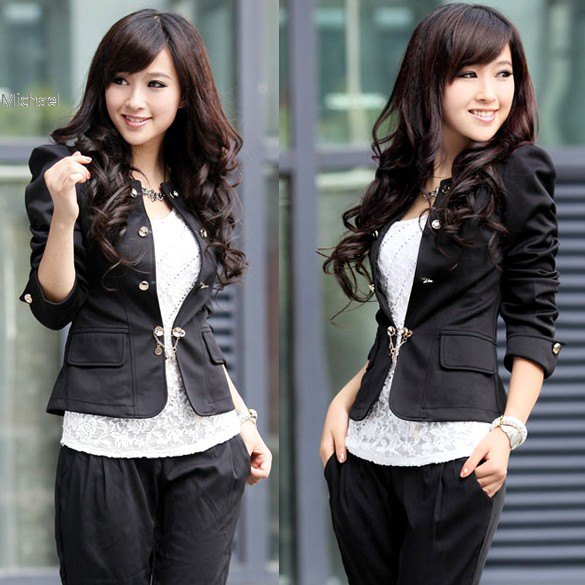 black waisted cotton blazer with lace top and loosely cut trousers