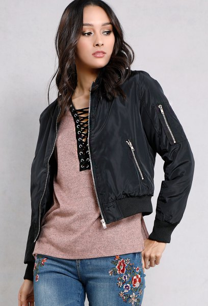 black fitted jacket with gray lace-up T-shirt and embroidered jeans