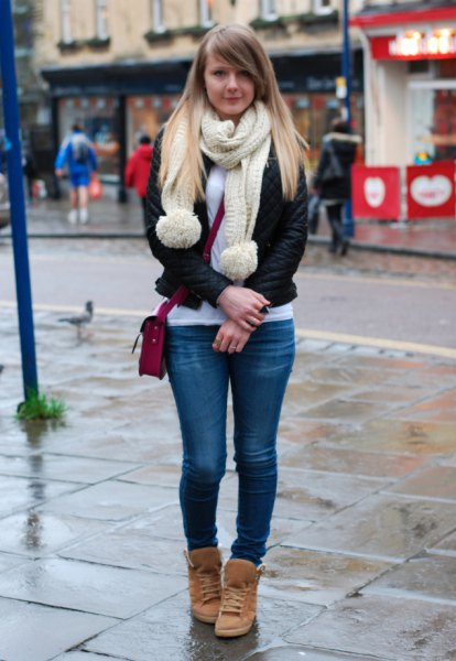 black tailored jacket with ivory-colored knitted scarf