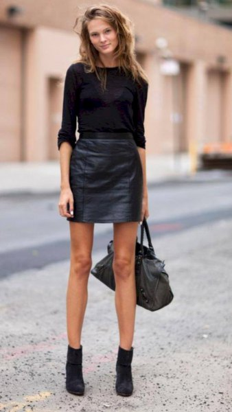 black fitted sweater with leather skirt and suede boots