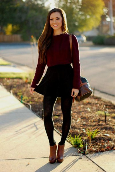 black fitted sweater with skater mini skirt and brown leather ankle boots