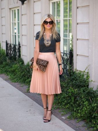 black cut t-shirt with pink high waisted midi pleated skirt