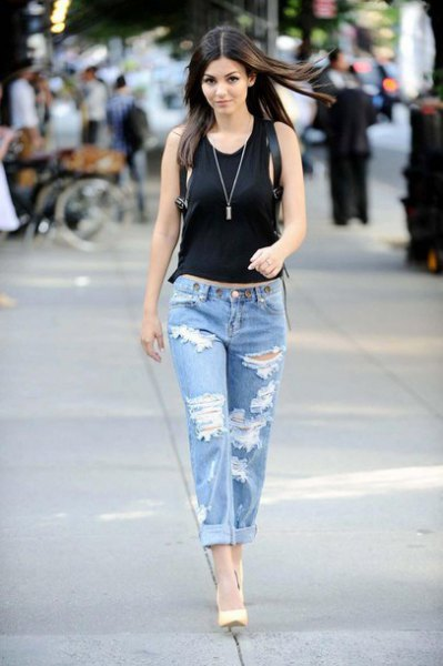 black waisted tank top with heavily torn baggy boyfriend jeans