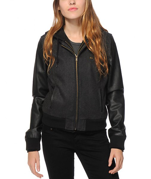 Black tinted bomber jacket with hood made of fleece and leather and skinny jeans
