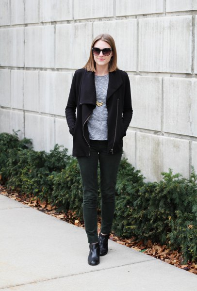 black fleece jacket with gray t-shirt with round neckline and dark gray corduroy jeans