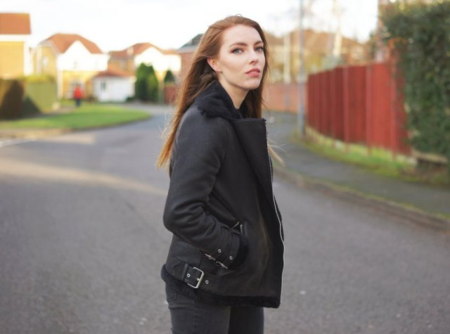 black flight jacket with matching slim fit jeans and boots