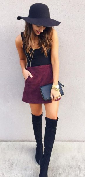 black floppy hat with tank top and suede skirt