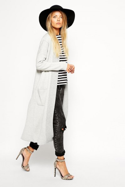 black floppy hat with white maxi cardigan and striped t-shirt